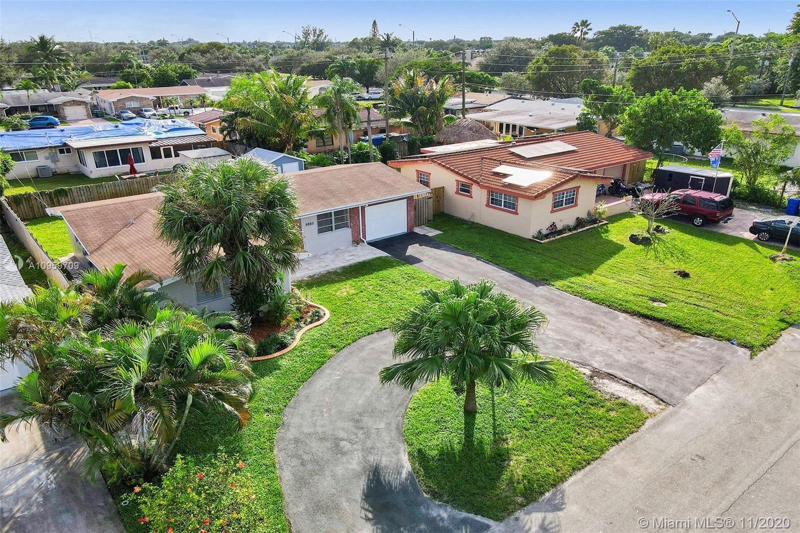 Photo of 8860 NW 16th St, Pembroke Pines, FL 33024 (MLS # A10959709)