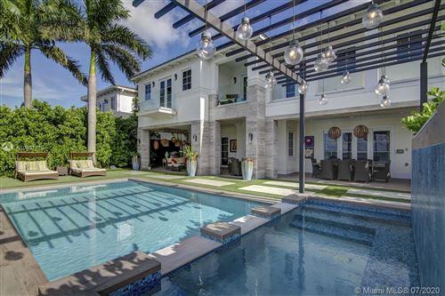 Photo of 1021 N Venetian Dr, Miami, FL 33139 (MLS # A10891710)