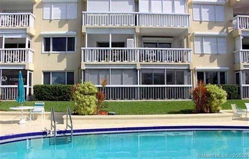 Photo of 629 SE 19th Ave #203, Deerfield Beach, FL 33441 (MLS # A10964710)
