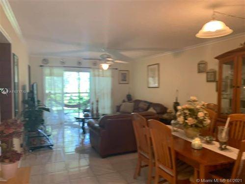 Photo of 9440 SW 8th St #303, Boca Raton, FL 33428 (MLS # A11071710)