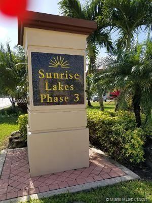 Photo of 8861 Sunrise Lakes Blvd #302, Sunrise, FL 33322 (MLS # A10988711)