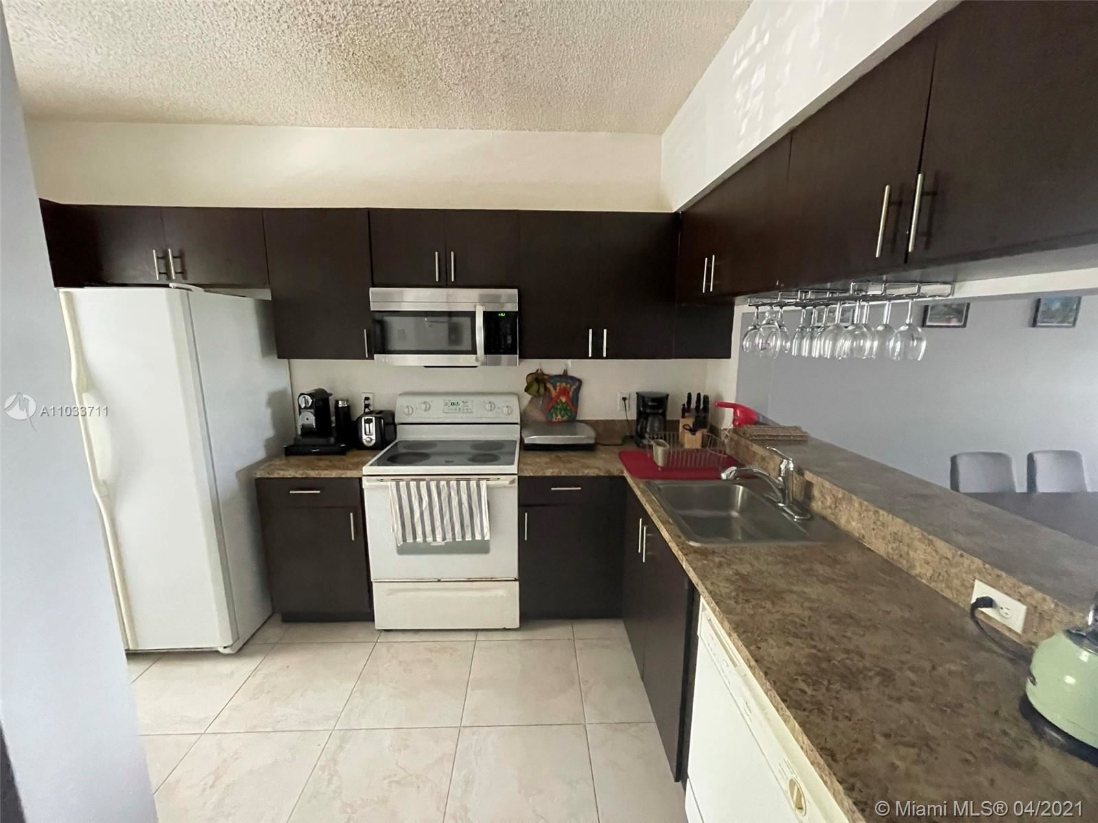 Photo of 3145 SW 50th St, Dania Beach, FL 33312 (MLS # A11033711)