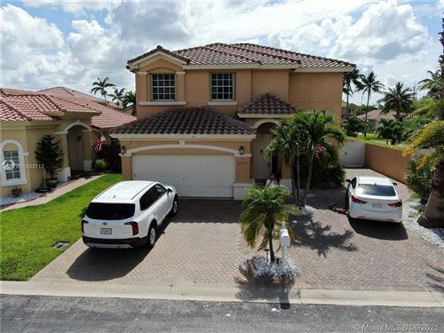 Photo of 2090 NW 99th Ter, Pembroke Pines, FL 33024 (MLS # A11053712)