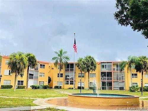 Photo of 4394 NW 9th Ave #20-3H, Deerfield Beach, FL 33064 (MLS # A11017714)