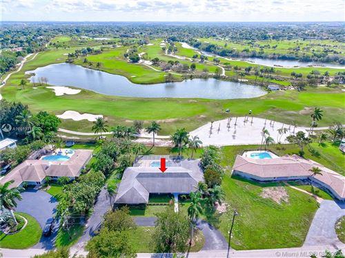 Photo of 6540 E Tropical Way, Plantation, FL 33317 (MLS # A10813715)