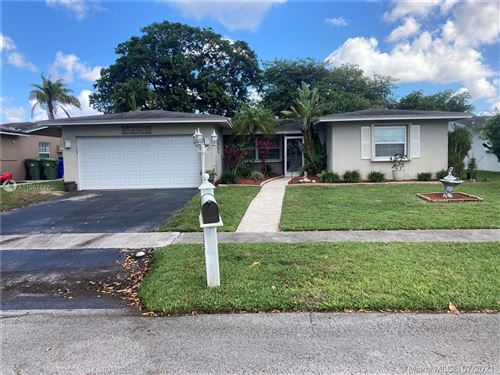 Photo of 9440 NW 23rd St, Pembroke Pines, FL 33024 (MLS # A11067717)