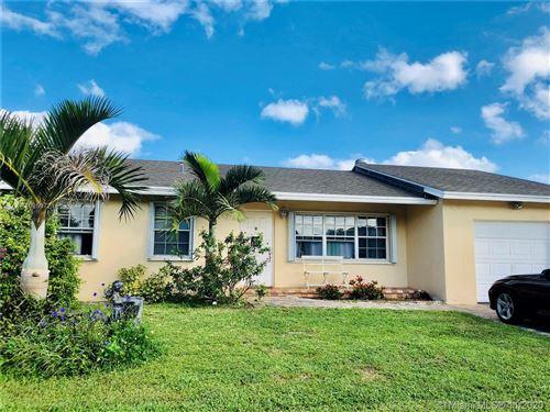 Photo of 9135 Saddlecreek Dr, Boca Raton, FL 33496 (MLS # A10959721)