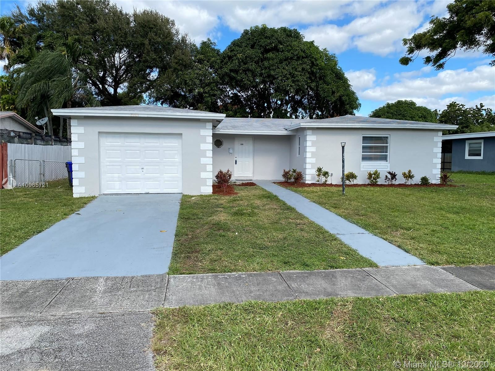 Photo of 6901 SW 7th Ct, North Lauderdale, FL 33068 (MLS # A10965721)