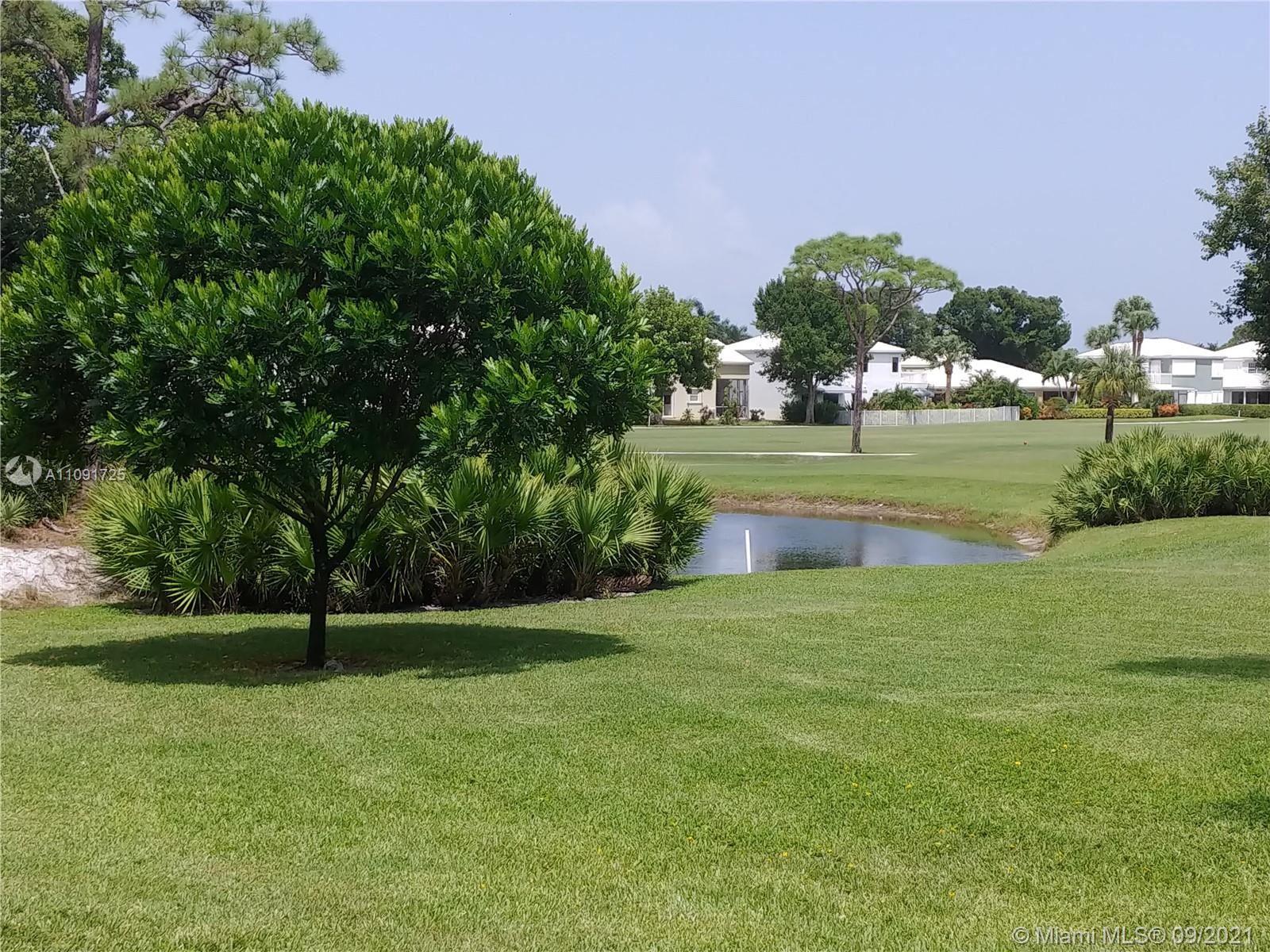 Photo of 18420 SE Wood Haven Ln #C, Tequesta, FL 33469 (MLS # A11091725)