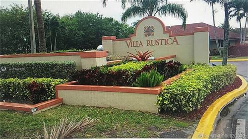 Photo of 18870 NW 57th Ave #102, Hialeah, FL 33015 (MLS # A10787726)