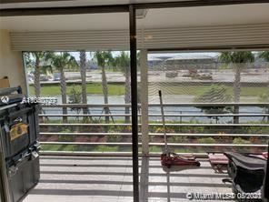 Photo of 4291 NW 9th Ave #202, Deerfield Beach, FL 33064 (MLS # A11040727)