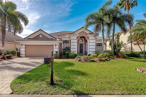 Photo of 10260 NW 60th Place, Parkland, FL 33076 (MLS # A10833729)