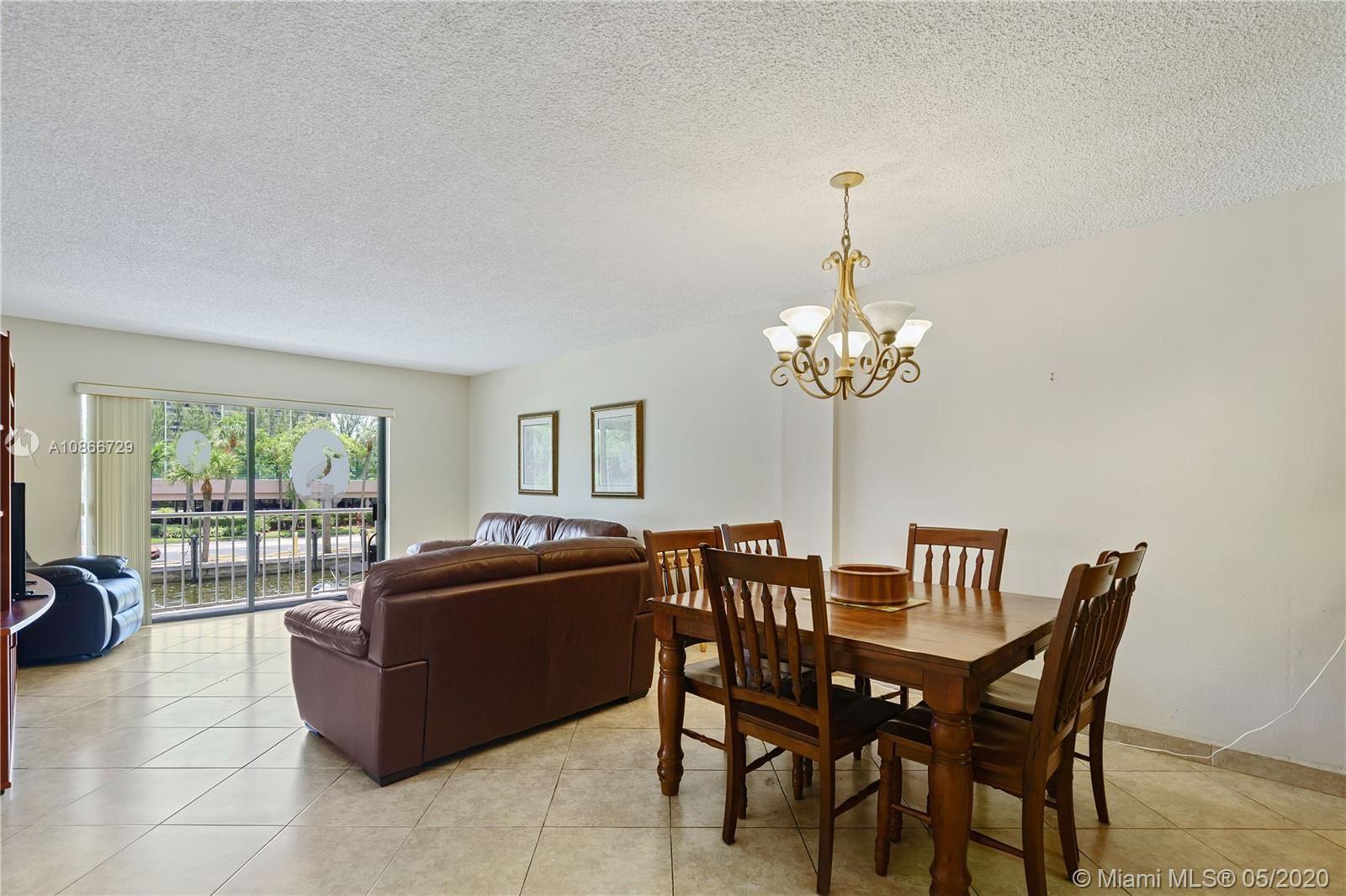Photo of 1650 NE 115th St #201, Miami, FL 33181 (MLS # A10866729)