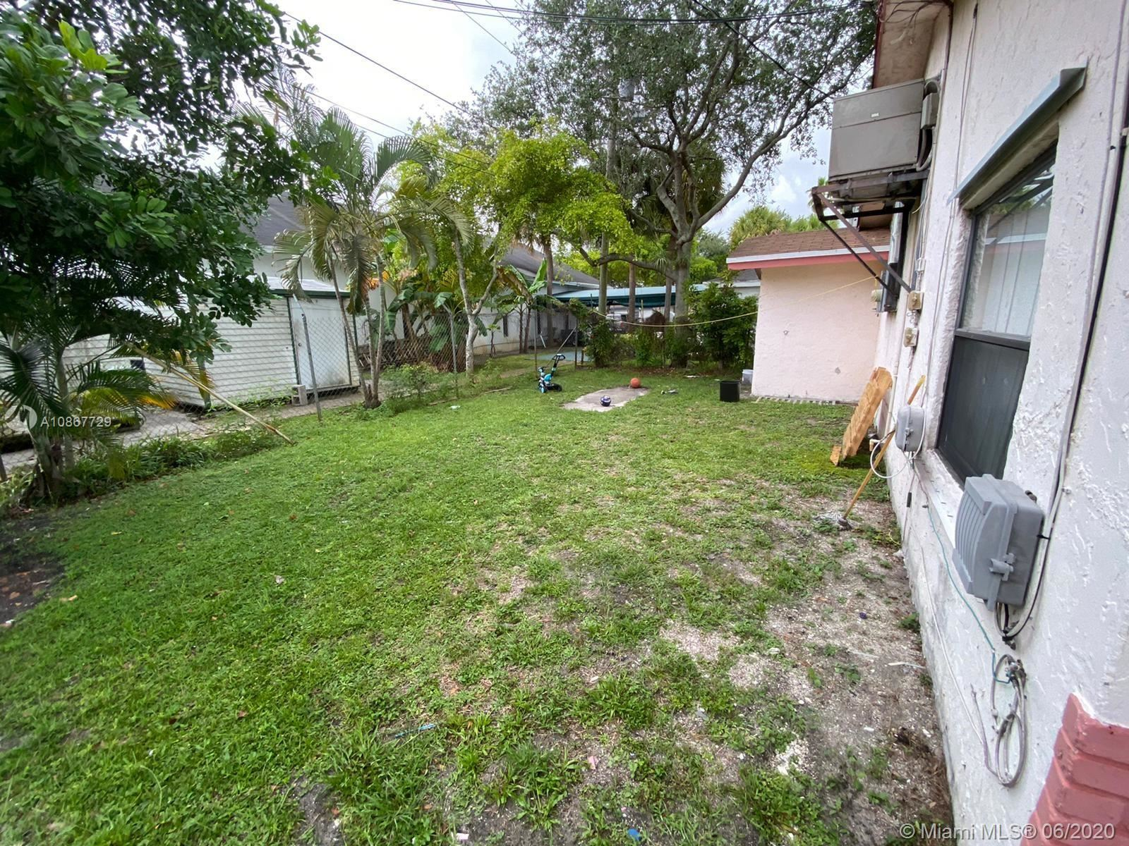 Photo of 2848 NW 13th Ct, Fort Lauderdale, FL 33311 (MLS # A10867729)