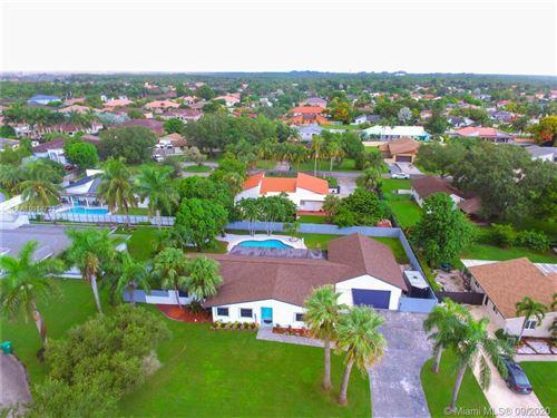 Photo of 12975 SW 190th Ter, Miami, FL 33177 (MLS # A10934733)