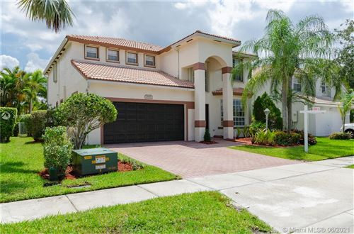 Photo of 1645 NW 143rd Ter, Pembroke Pines, FL 33028 (MLS # A11058733)