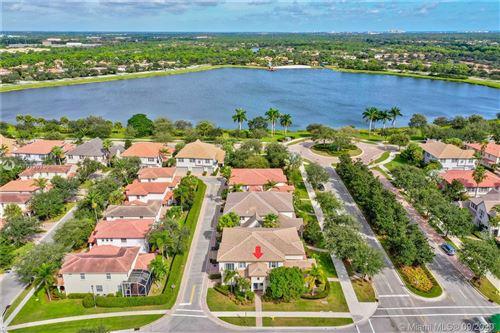 Photo of 131 Evergrene Pkwy #131, Palm Beach Gardens, FL 33410 (MLS # A10926736)