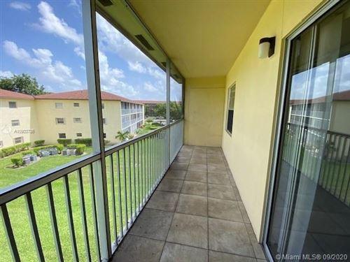 Photo of 151 SW 135th Ter #310, Pembroke Pines, FL 33027 (MLS # A10933736)