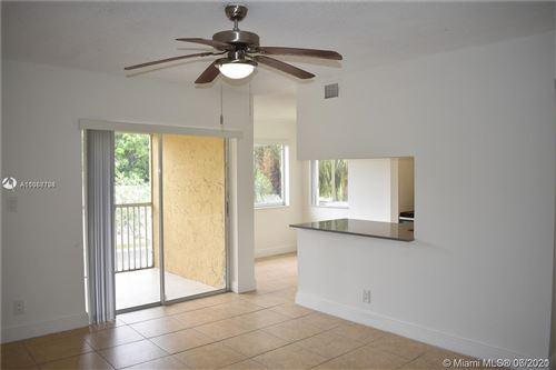 Photo of 5760 Rock Island Rd #318, Tamarac, FL 33319 (MLS # A11058736)