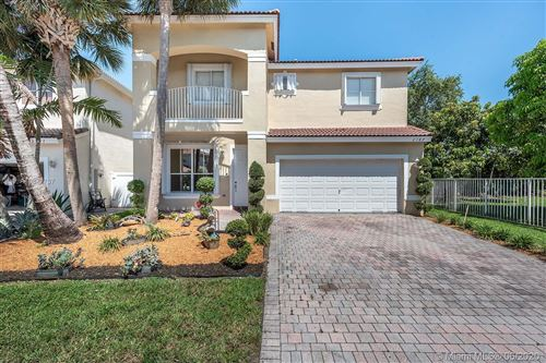 Photo of 2187 NW 77th Ter #., Pembroke Pines, FL 33024 (MLS # A10877737)