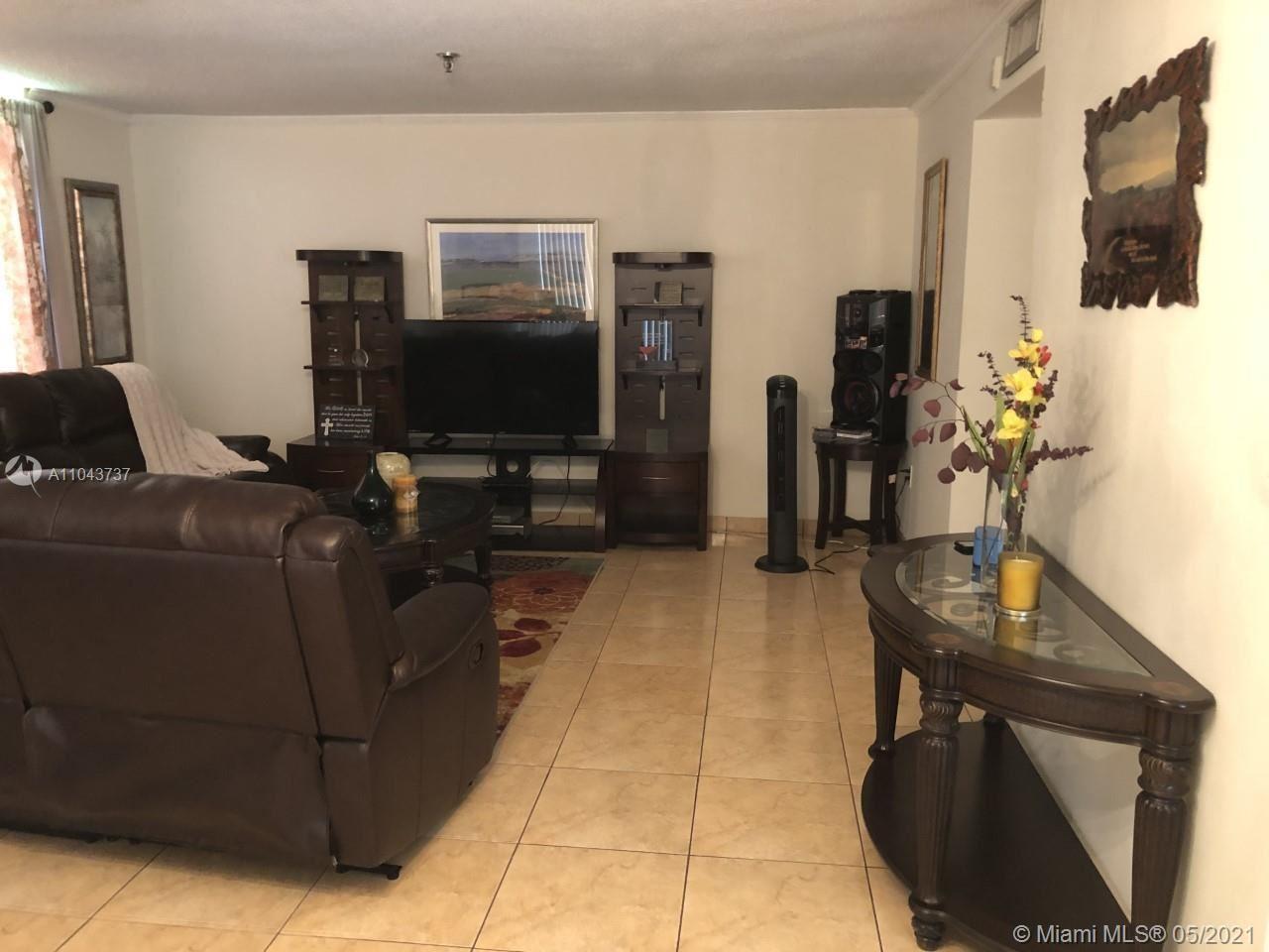 Photo of 671 NE 195th St #402E, Miami, FL 33179 (MLS # A11043737)