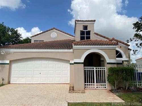 Photo of 1444 Harbour Side Dr, Weston, FL 33326 (MLS # A10933738)