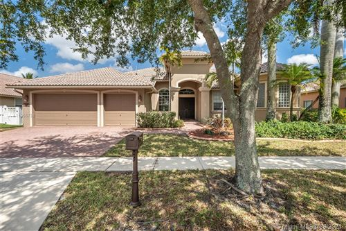 Photo of 1213 NW 137th Ter, Pembroke Pines, FL 33028 (MLS # A11055738)