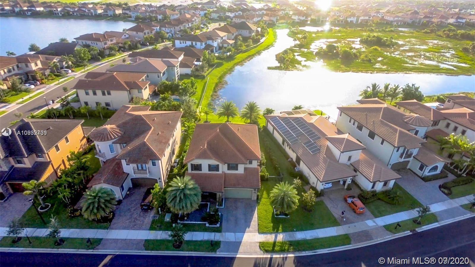 Photo of 9125 Carrington Ave, Parkland, FL 33076 (MLS # A10932739)