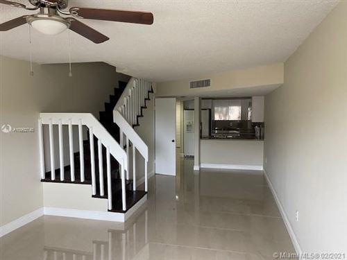 Photo of 180 Royal Palm Rd #205, Hialeah Gardens, FL 33016 (MLS # A10992740)