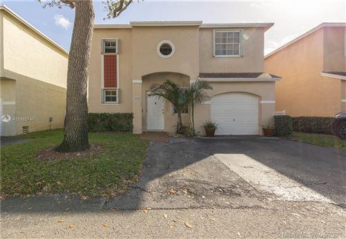 Photo of 11938 NW 12th St, Pembroke Pines, FL 33026 (MLS # A10985741)
