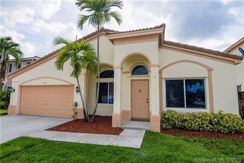 Photo of 1442 SW 106th Way, Davie, FL 33324 (MLS # A10890742)