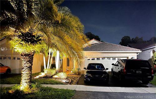 Photo of 515 Talavera Rd, Weston, FL 33326 (MLS # A11107742)