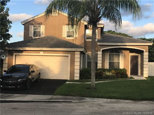 Photo of 5252 NW 55th Ter, Coconut Creek, FL 33073 (MLS # A10756744)