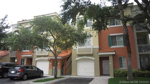 Photo of 11026 Legacy Dr #203, Palm Beach Gardens, FL 33410 (MLS # A10906745)