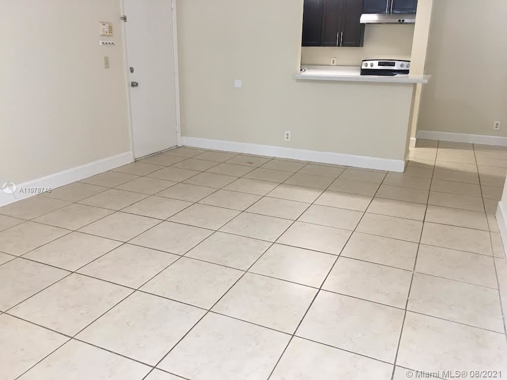 Photo of 10757 Cleary Blvd #104, Plantation, FL 33324 (MLS # A11078745)