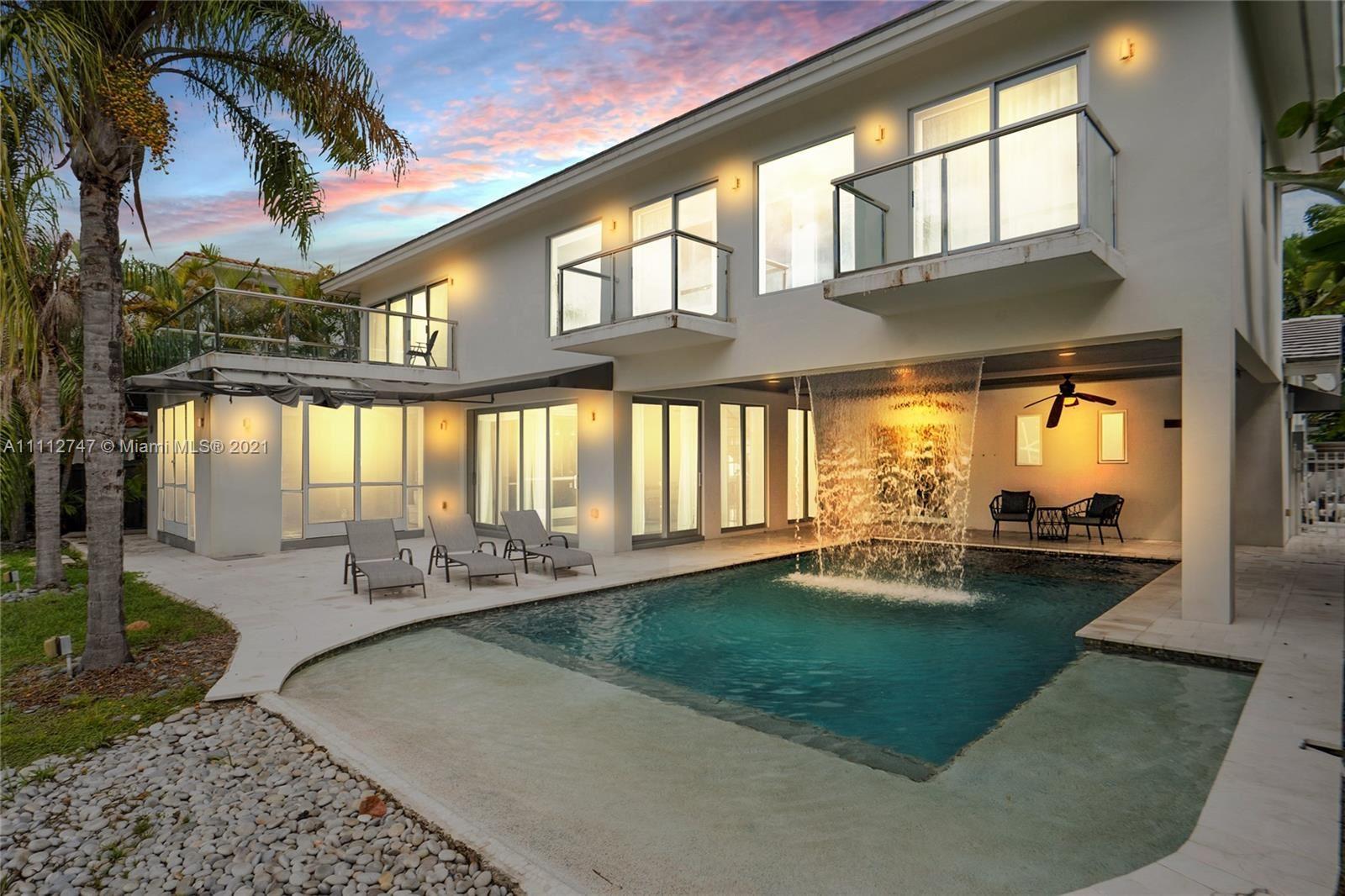Photo of 13100 Coronado Ln, North Miami, FL 33181 (MLS # A11112747)