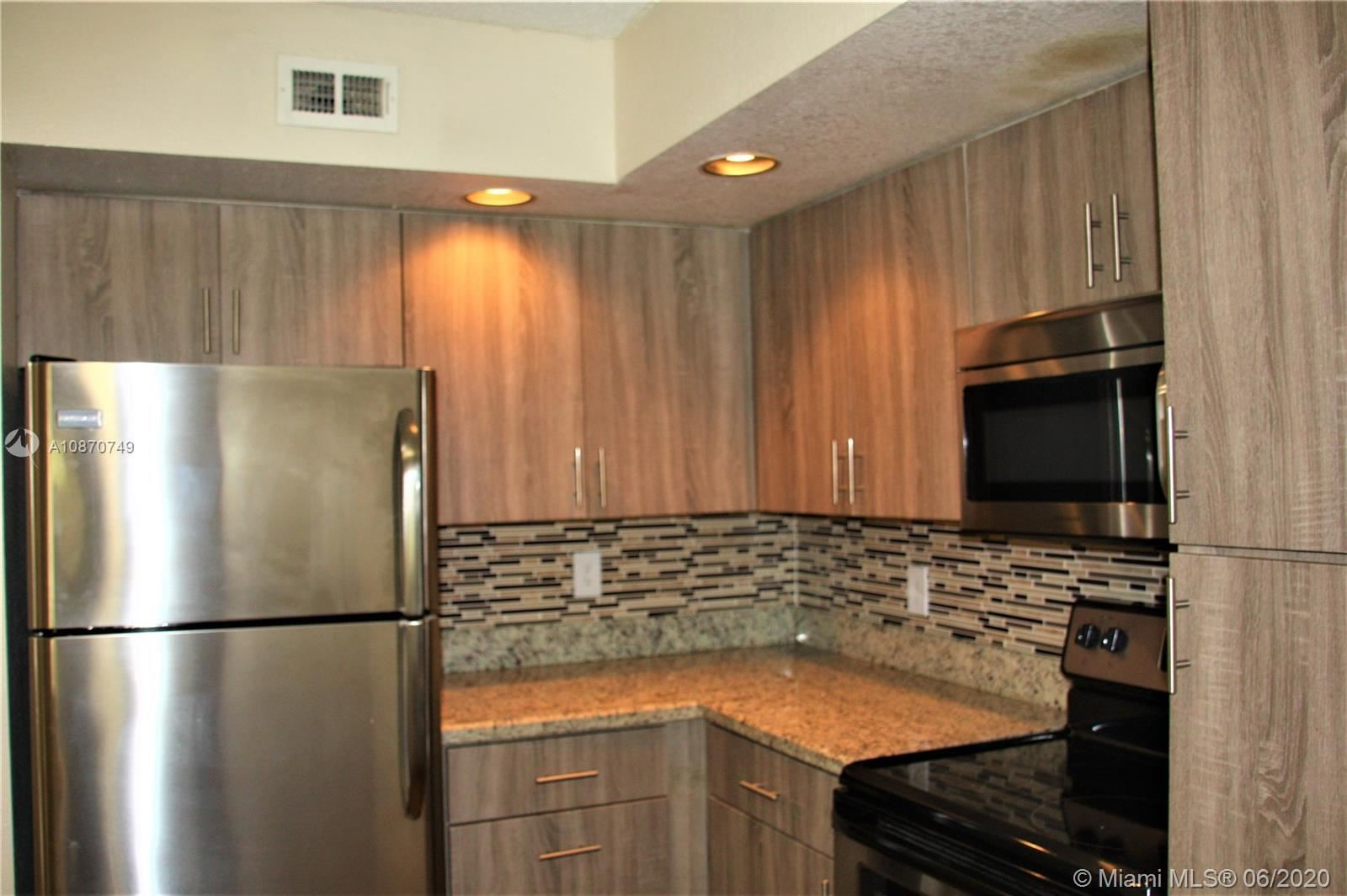 Photo of 12760 Vista Isles #713, Sunrise, FL 33325 (MLS # A10870749)