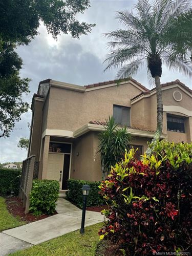Photo of 7525 NW 61st Ter #3301, Parkland, FL 33067 (MLS # A11089754)