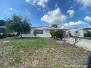 Photo of 1611 W 12th Ct, Riviera Beach, FL 33404 (MLS # A11037755)