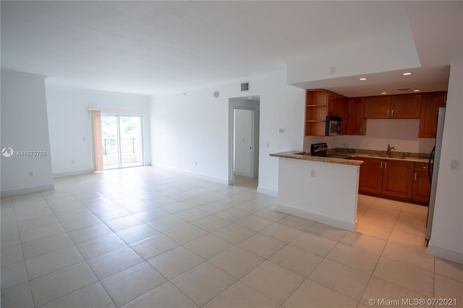 Photo of 20 Calabria Ave #201, Coral Gables, FL 33134 (MLS # A11073758)