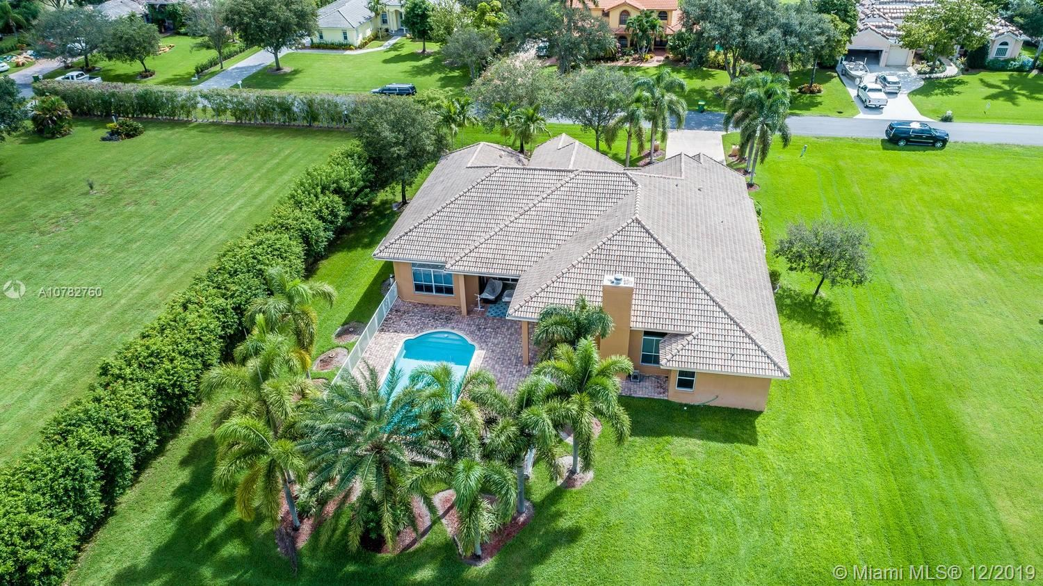 Photo of 831 NW 115th Ave, Plantation, FL 33325 (MLS # A10782760)