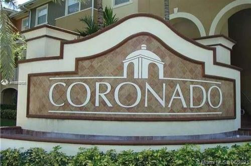 Photo of 10805 NW 89th Ter #209-4, Doral, FL 33178 (MLS # A11060761)