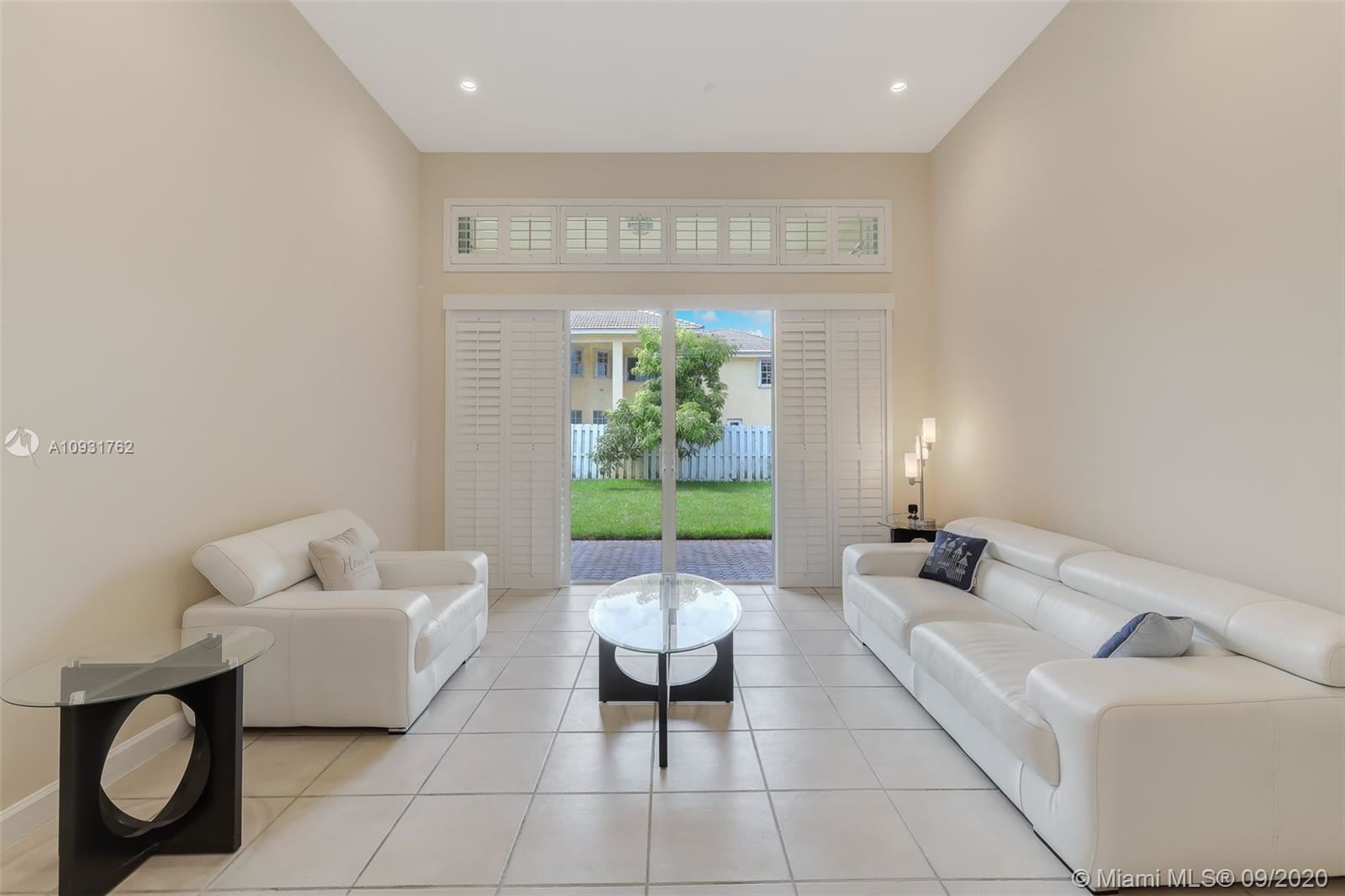 Photo of 1228 NW 165th Ave, Pembroke Pines, FL 33028 (MLS # A10931762)