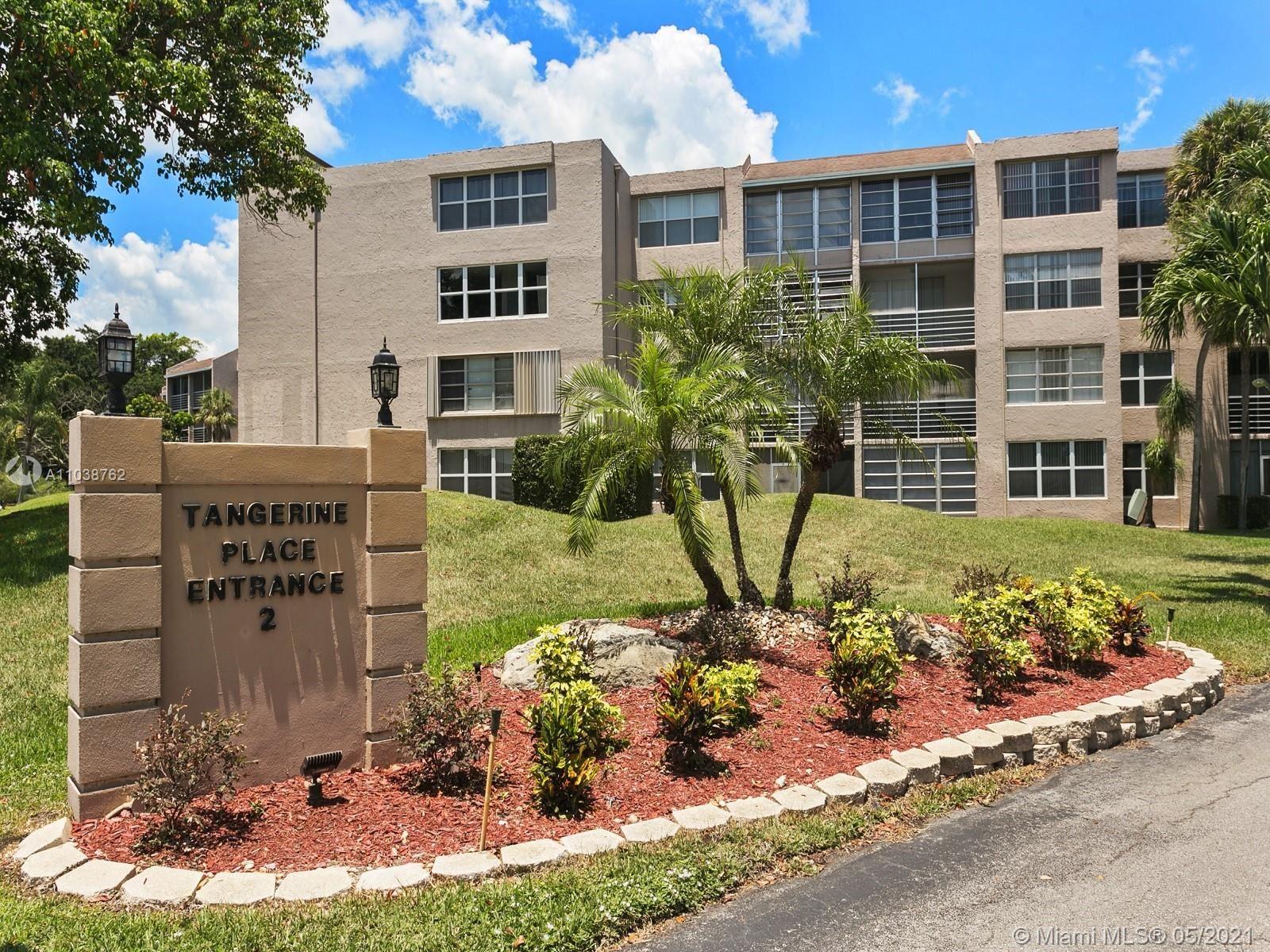 Photo of 9440 Tangerine Pl #401, Davie, FL 33324 (MLS # A11038762)