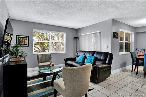Photo of 8600 SW 212th St #211, Cutler Bay, FL 33189 (MLS # A10986763)