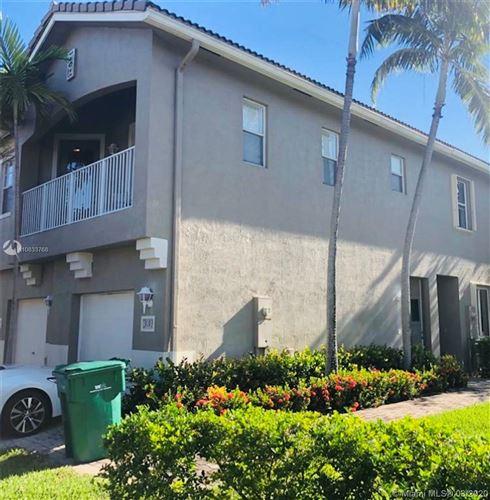 Photo of 3193 Laurel Ridge Cir #1, Riviera Beach, FL 33404 (MLS # A10833768)