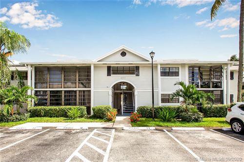 Photo of 827 NE 199th St #108, Miami, FL 33179 (MLS # A10931768)