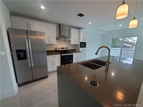 Photo of 414 Foster Rd #101, Hallandale Beach, FL 33009 (MLS # A11057769)
