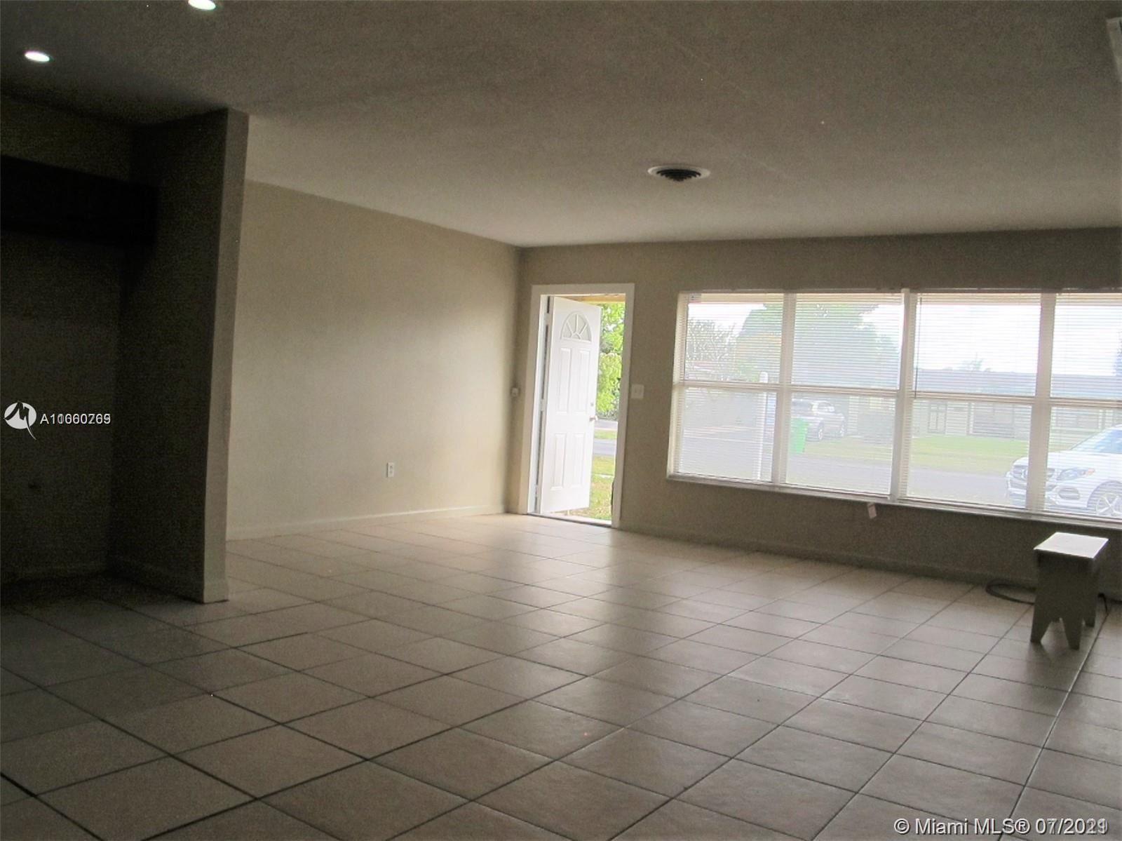 Photo of 5979 NW 15th St, Sunrise, FL 33313 (MLS # A11060769)