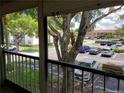 Photo of 4167 NW 90th Ave #201, Coral Springs, FL 33065 (MLS # A10783771)